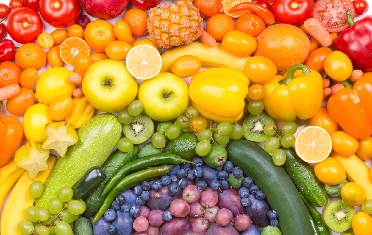 Colorful fruits and vegetables, arranged to look like a rainbow